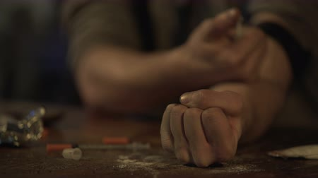 methamphetamine : Hand of depressed man making drug injection with syringe at abandoned place Stock Footage