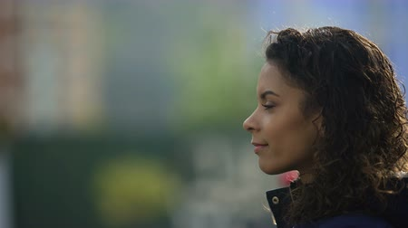 make photo : Beautiful biracial young lady portrait in profile, inspired woman model smiling