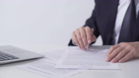 lucrative : Company president reading contract, signing important cooperation agreement
