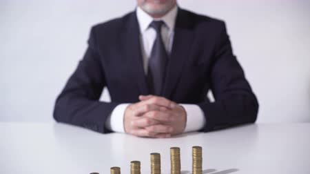 lucrative : Wealthy man sitting in front of coin piles, growth of deposit interest, banking