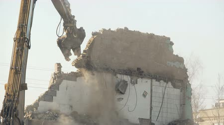 tyranny : Strong demolition tool crashing old wall, breaking rules, fighting stereotypes