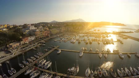 penetrating : Sunrise beams penetrating Italian town with nice architecture and luxury marina