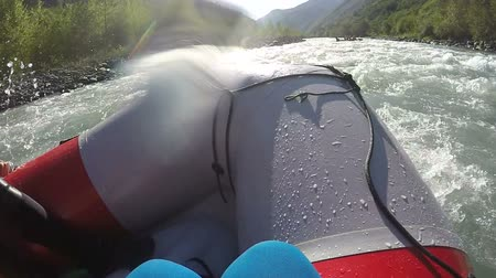 avoiding : Rafting team masterly avoiding rapids, paddling boats down the wild river Stock Footage