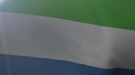 sierra leone flag : Flag of Sierra Leone waving on flagpole in the wind, national symbol of freedom Stock Footage