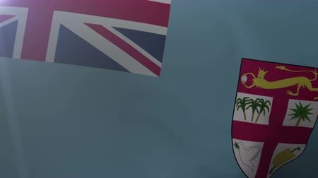suva : Flag of Fiji waving on flagpole in the wind, national symbol of freedom