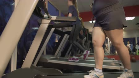 self motivated : Young lady with big belly and fat hips exercising on treadmill, weightloss