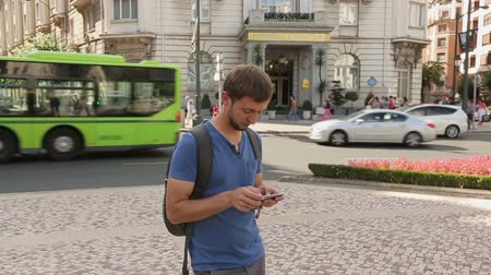 kept : Backpacker checking public transportation schedule using app on smartphone