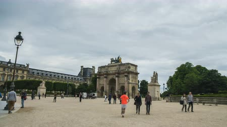 triumphal arch : Tourists approaching and going through triumphal arch, Place du Carrousel, Paris