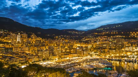 lights up : Monaco illuminated by night lights, luxury resort with elite yacht club, aerial