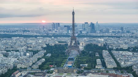 impressive skyline : Center of Paris with Eiffel Tower against setting sun and illumination lit after