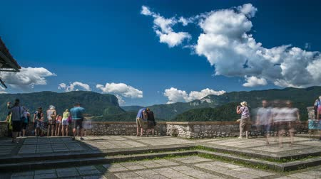 points of interest : Tourists posing and taking pictures at observation site in mountains, time lapse Stock Footage