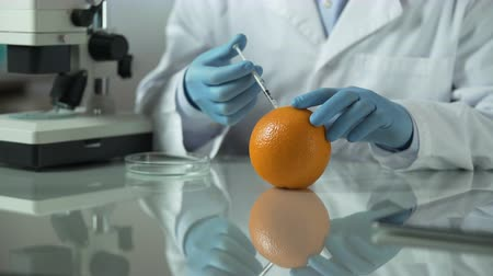 mutation : Scientist preparing anti-cellulite extract from orange peel, cosmetic laboratory Stock Footage