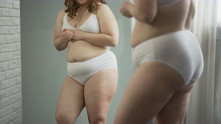 embarrassed : Sad girl embarrassed about her cellulite body and excess weight, health problem