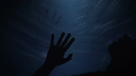 bloody hands : Dying silhouette of victim, creepy scene of murder, horror, slow-motion