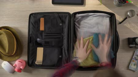 bilet : Travel suitcase packed quickly, preparations for vacation trip, time lapse