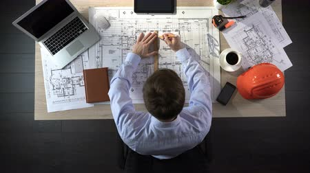 designing : Representative of construction company preparing drawing of office building