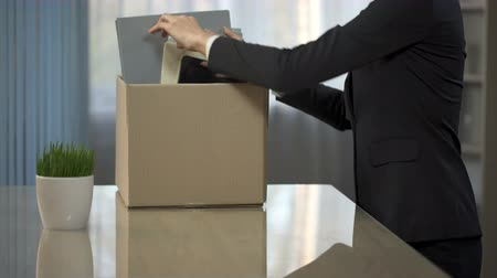 umutlu : Woman putting her things from office desk into box, getting promoted, career