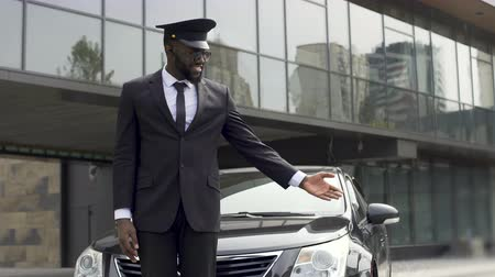 cortes : Luxury taxi service driver welcoming very important client near expensive car