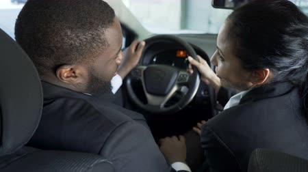 tricky : Tricky secretary actively flirting with boss in his car to move up career ladder Stock Footage