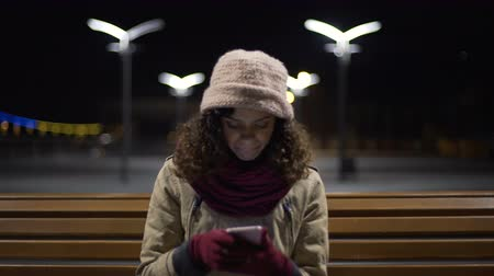 curly haired : Woman scrolling websites on gadget, looking for internet shop with brand clothes Stock Footage