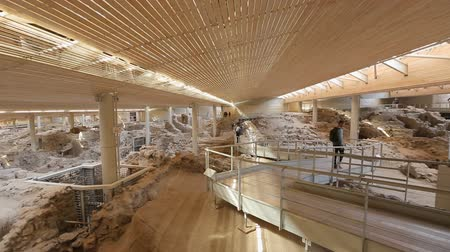 millennium : Excavation site of Akrotiri settlement on Santorini with walkway for visitors Stock Footage