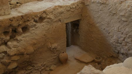 buried : Room of excavated ancient house in Akrotiri with kitchen pottery standing in it