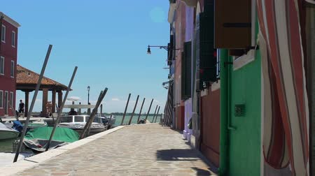 burano : Burano Island inhabitants lazily going to work on windy working Fridays morning Stock Footage