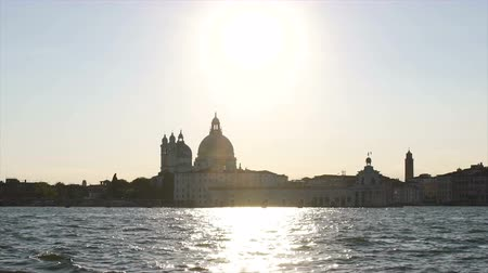 ziyaret : Grand Canal waves sparkling in sunshine, Saint Mary of Health church in Venice Stok Video