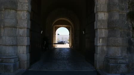 fortifying : Ancient stone arched entrance to Cascais Citadel with courtyard at end, sequence Stock Footage