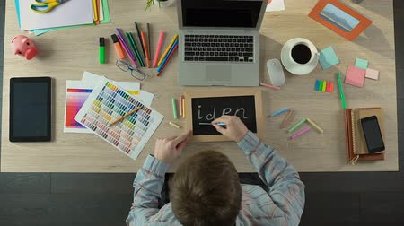 decorador : Freelancer writing idea on blackboard, motivation and inspiration at work Stock Footage