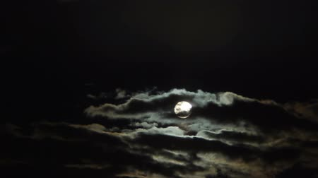 fullmoon : Thick cumulus clouds hiding full moon at midnight, mysterious sky, astronomy