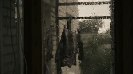 cold war : Laundry on balcony, stormy weather and rain outside, hurricane approaching Stock Footage