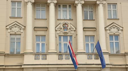 croatia : Architecture of Zagreb, flags of European Union and Croatia hanging on building Stock Footage