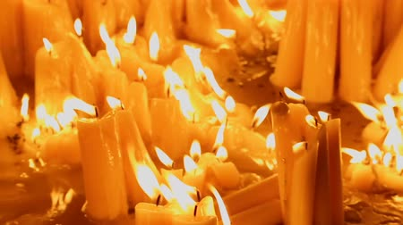 felvonás : View on beautiful burning candles at the church, place of accident, memorial Stock mozgókép
