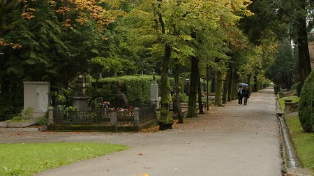 надгробная плита : Two women walking on Mirogoj cemetery park in Zagreb, memorial place, Croatia