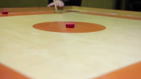plywood : Beginner playing carrom game, friends having fun at leisure, indoor activity Stock Footage