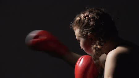 sampiyonlar : Professional female Muay Thai boxer doing air punching training in the gym