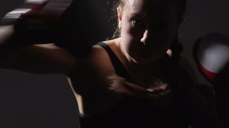 self defense : Attractive strong female kickboxer training before competition, combat sport Stock Footage