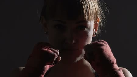 self defense : Strong independent female boxer looking into camera, fight for women rights