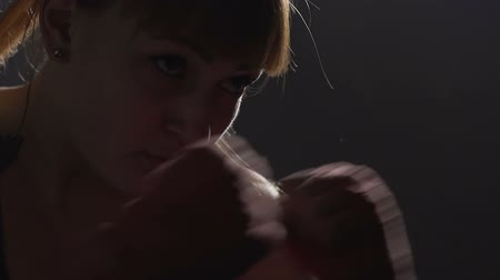 bandage : Professional female kickboxer boxing before fight, preparing for championship Stock Footage