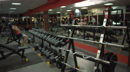 equipped : Gym room with visitors doing exercises, gym atmosphere, healthy lifestyle