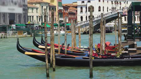 water taxi : Beautiful gondolas docked in Venice canal, water transport, sightseeing tour