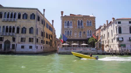 water taxi : Man sailing along Grand Canal by motorboat, private water transport in Venice