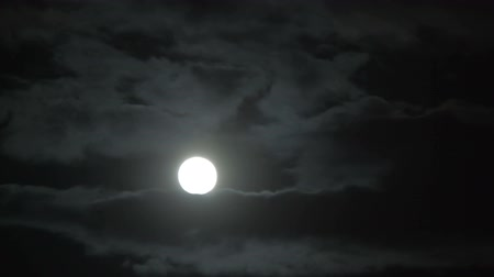 távcső : Bright lunar disk breaking through thick clouds like goodness trying defeat evil