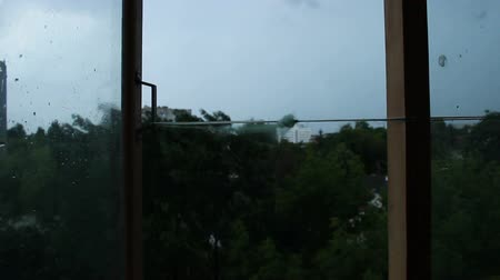 surroundings : Strong stormy wind blowing through open window, hurricane destroying building