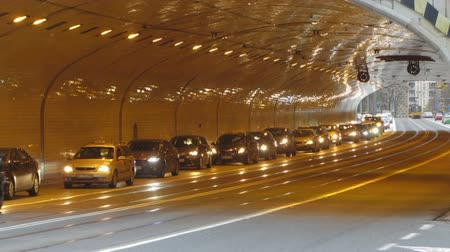 rapid transit : Automobiles driving with caution into tunnel equipped with new lights, traffic