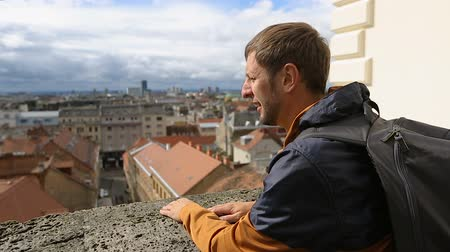 chorvatský : Man tourist enjoying breathtaking cityscape, male looking on the city roofs