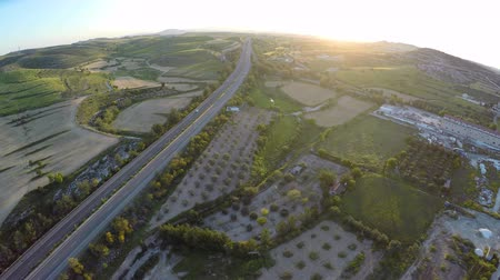 anlamlı : Agricultural fields and fruit gardens on Cyprus hills, road traffic, aerial view