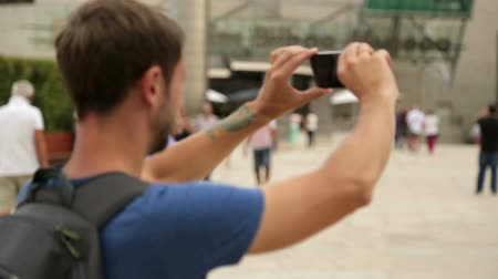 remember : Tourist taking video with smartphone in front of museum in Bilbao, travel