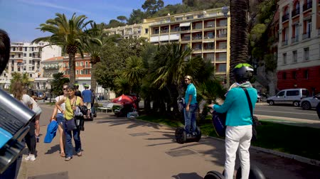 rivera : Tourists riding segways and strolling along seaside viewing platform, travel